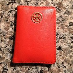 Red/orange Tory burch wallet *authentic* Gently used with some wear on corners and on ID part as shown in pictures but otherwise very cute and functional! Tory Burch Bags Wallets