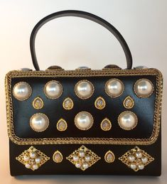 Faux pearls, gold chains and a variety of gold hued baubles adorn this amazing up-cycled retro purse. Original leather lining 22 cm x 16 cm x 7 cm (strap adds 9 cm in height) Handcrafted, minor imperfections trashed number 126 tag (removable) Gold Chains, Hue, Im Not Perfect, Upcycle, Gemstones, Pearls, Purses, Retro, Upcycling