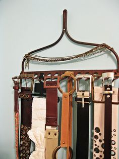 Here's a neat idea to organize your belts at home or display them in your boutique. Rake Belt hanger, also used for necklaces. What else would you hang on an upside down rake head?