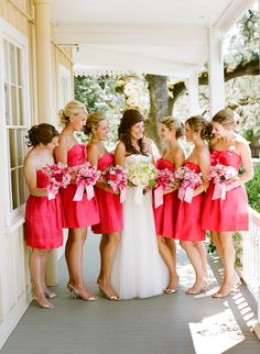 bride with bridesmaids in short hot pink dresses - photo by San Francisco based wedding photographer Lisa Lefkowitz