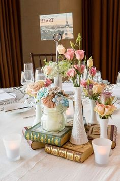 Mix up real flowers with crafted ones and gilded old books for this fab centerpiece