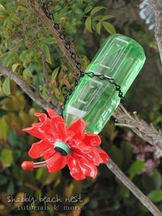 Hummingbird feeder from water bottle and plastic spoons!