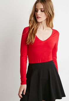 Forever 21 is the authority on fashion & the go-to retailer for the latest trends, styles & the hottest deals. Shop dresses, tops, tees, leggings & more! Cute Girls, Ponytail Girl, Bridget Satterlee, Silhouette, V Neck Tops, Gorgeous Women, Fashion Models, Fashion Dresses, Shopping