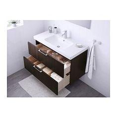 IKEA - GODMORGON / ODENSVIK, Skab til vask med 2 skuffer, sortbrun, , 10 års garanti. Læs betingelserne i garantifolderen.Letløbende skuffer med skuffestop. Lukker blødt.Du kan nemt ændre størrelsen på boksen ved at flytte opdeleren.Skufferne har fuldt udtræk, og det gi'r overblik og nem adgang til indholdet.Skuffer fremstillet af massivt træ. Bund af ridsefast melamin.Den medfølgende vandlås er fleksibel, så den er nem at forbinde til afløb, vaskemaskine eller tørretumbler.Vandlåsens unikke…