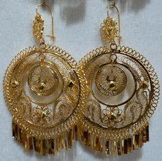 aretes de filigrana del Juchitán bañados en oro