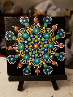 Hand-painted Canvas By Miranda Pitrone Colorful Dot Art Mandala Design Size: 4x4 Medium: Acrylics on Canvas Colors: White, Coral, Green, Blue, Turquoise, Red