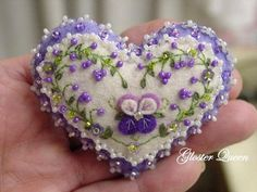 A lot of work goes into making these little pansy pins, Ive hand embroidered and beaded nearly everywhere. Ive also added darling little flower sequins, and a Swarovski rhinestone montee to the center of the pansy. A pansy lover is going to love this one. Hand Sewing Projects, Sewing Crafts, Fabric Hearts, Felt Decorations, Valentine Crafts, Valentines, Felt Hearts, Mobiles, Felt Ornaments