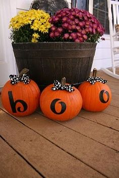 love this idea & add a fourth pumpkin & change the word to fall / change the bows out. Leave the pumpkins wordless for double season decorating.