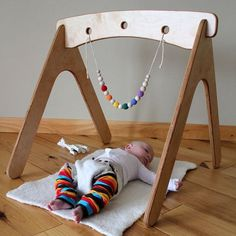 Via Apartment Therapy. A plywood baby gym from Etsy Shop Highland Wood. could be DIY'd. Elegant.