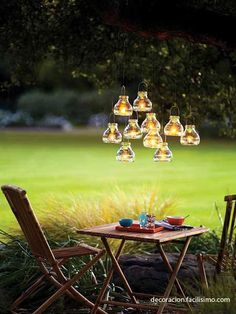 Create romantic lighting for an outdoor dinner party by suspending votives (we used mini recycled-glass tea light lanterns) at varying heights from low-hanging branches. Use clear fishing line and be sure to keep candles a safe distance from the leaves. Tea Light Lanterns, Tea Lights, Jar Lanterns, Lights In Trees, Ideas Lanterns, Green Lights, Garden Lanterns, Twinkle Lights, Fairy Lights