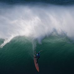 American big wave surfer Nic Lamb drops a wave off Praia do Norte in Nazare during the first edition of the World Surf League's Nazare Challenge.  Picture: Francisco Leong/AFP/Getty Images #surf #surfing #surfer #bigwave #bigwavesurfing #surfingcompetition #worldsurfleague #nazarechallenge