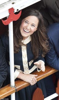 A delighted-looking Pippa Middleton smiles as she makes her way down the Thames