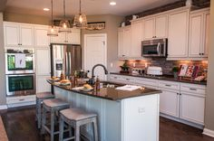 Choose a backsplash that matches your tastes, like this brick backsplash with white cabinets. Seen in the Clay Coastal Classic. | Fischer Homes