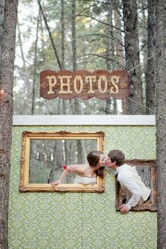 Make a piece of plywood into a beautiful photo op for the wedding couple and guests to use throughout the evening. Plywood, wallpaper or paint and some thrift store frames painted with metallic paint.