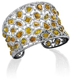 CELLINI Fancy Yellow Diamond Cuff-18-karat white gold cuff featuring various shades of of fancy yellow diamonds in an assortment of cuts framed with white diamonds