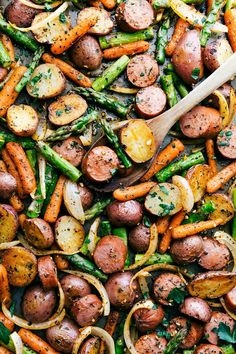 ONE PAN ROASTED GARLIC POTATOES AND SAUSAGE! Red potatoes, asparagus, carrots, and sausage all with herbs. Recipe via chelseasmessyapron.com