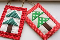 Bitty Trees Quilted Ornaments - Take some small scraps from your Christmas fabric stash and make some adorable DIY Christmas ornaments. These adorable holiday quilt projects will only take you about an hour to sew up, will cost almost nothing to make, and will look absolutely precious on your tree.
