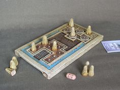"Knossos game is the ancient board game discovered by Evans in the Palace of Knossos and goes back to 1600 BC. It is a ""race game"", but at the same time something more. It portrays an ancient symbolism about life and the trip to Hades with a return back to life. A gap between the two parts of the board was supposed to be the River-Ocean that separates the world of the living from the world of the dead, to be found far beyond the sea, where the Sun descends."