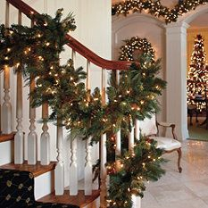 Green garland and white lights - creates a Christmas flow throughout all these spaces that is simple but stunning.
