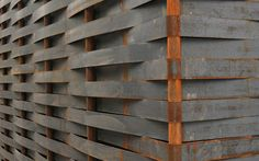 Kunsthaus Art House Extension by ssm Architekten ag. Facade is braided 5/100mm steel stripes