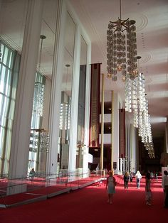 """The """"John F. Kennedy Center for the Performing Arts""""  The Grand Foyer, at 63 feet high and 630 feet long, is one of the largest rooms in the world.  If laid on its side, the Washington Monument would fit in this room with 75 feet (23 m) to spare."""