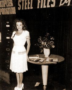 Marilyn Monroe ~ Norma Jean acting as a hostess, one of her ways to get discovered while working for the Blue Book Modeling Agency.