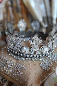 Crowns and tiaras have been in the royal families for centuries. They go back to ancient Greece, where Greek Gods and Kings were seen wearing ornamental headdresses to establish their authority. Customs of wearing crowns varies from country to country. The crowns really add to the princess look!