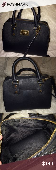 Michael Kors black leather purse/satchel Black leather Michael Kors purse with gold detailing. Was given to me as a gift, but was originally purchased at Macy's less than a year ago ( means it is an actual legit MK). The bag looks practically brand new, amazing condition!  I'd say it is about 10 in long and 6 tall💕 Matching wallet is also on my page!! 😊 Michael Kors Bags Satchels