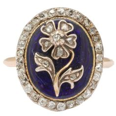 Enamel, Diamond Locket Back Daisy Ring | From a unique collection of vintage more rings at https://www.1stdibs.com/jewelry/rings/more-rings/