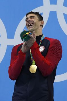 #RIO2016 USA's Michael Phelps laughs on the podium with his gold medal after he…