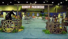 This western entrance with Howdy Pardner sign, horse corralled within split rail fence and wagon wheels, is a great welcome to your event whether its a summer picnic, trade show or theme party.