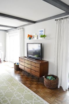 Living On The Ledge | Young House Love shelf above tv...bracket on top instead of underneath