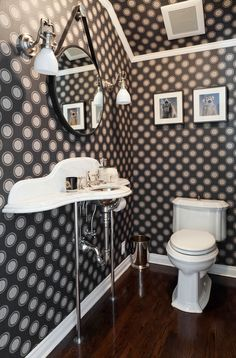Contemporary Powder Room with Hardwood floors, Urban trends collection hanging metal mirror, interior wallpaper, Wall sconce Interior Wallpaper, Cool Wallpaper, Console Sink, Bathroom Cabinetry, Metal Mirror, Dream Decor, Better Homes, Amazing Bathrooms, Powder Room