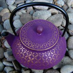 """Ume Houshu"" - 24 ounces (~ 3-4 cups) Meaning 'plum jewel', the Ume Houshu is a striking teapot with a dynamic color structure. Deep plum purple washes over the gold base which is decorated with a raised four-point petal design. This cast iron teapot includes a fitted fine mesh tea strainer. - From the Nanbu Cast Iron Studio/Morioka"