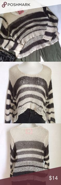 """✨NEW Listing✨Ivory & grey striped hi-lo sweater Long sleeve loose knit Ivory and charcoal grey striped sweater with a high-lo hemline. Scoop neckline. It's see through and would require an undershirt or cami. Size is not labeled, but shown on a small size mannequin with 36"""" bust. 100% acrylic. BCBGMaxAzria pants & Bijou Bijou bag available in separate listings. Not interested in trades. NWOT Strawberry on the Cake Sweaters Crew & Scoop Necks"""