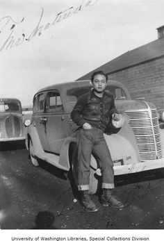 Young Japanese man leaning up against an automobile, probably at the Tule Lake Relocation Center, California, ca. 1942-1946