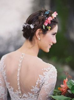 Lovely up do hairstyle for the bride with fresh flowers