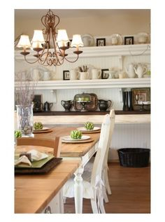 i love these long shelves in the dining room! I could do so much thing putting with them....