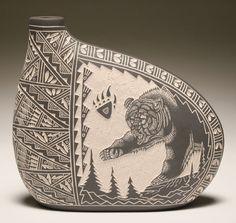 sgraffito (scratching) decoration on slab pot.