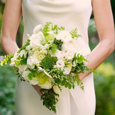 Possible bridal bouquet. Cala lillies, white roses, succulents and ferns.