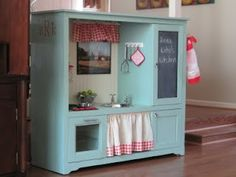 Old entertainment center = new kitchen for little girls.  So adorable.