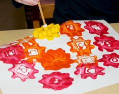 Preschool Art Projects - creating a rainbow while painting with gears
