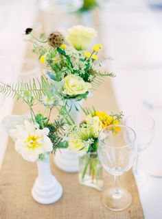 Flowers in milk glass vases