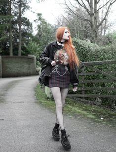 Olivia Emily wears Vintage Cat Tee, fishnet long sleeve top, Mary Wyatt Belt, Plaid Skirt, and Underground Creepers