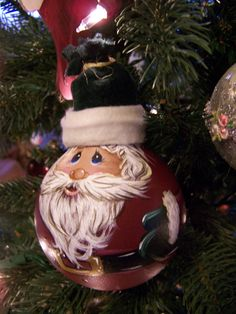 Hello, this is a listing for a hand painted Santa ornament from a repurposed vanity bulb. These are made to order and can also be personalized