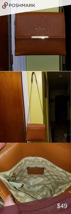"""$4.99 shipping until 12:00 am tonight Kate Spade Brown, with chain strap. Strap is 21"""" and has leather covering at the shoulder for comfort. From the top of the shoulder to the bottom of the purse is 27"""". Interior of purse is 6"""" deep, 8"""" wide. Has two compartments as shown in pics 3 and 4. Each compartment has a pocket, one has zipper closure. Pic 5 is the exterior pocket with button closure. Pics 7&8 show some wear on the shoulder strap. Bought this on Posh, so I dont have the original…"""