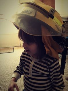 Althea's with her late Paw Paw's Helmet.