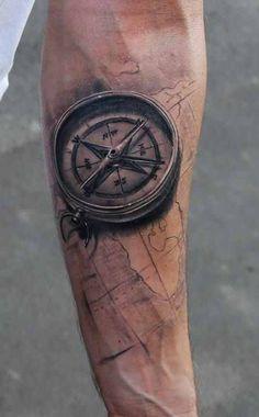 cool compass tattoo on sleeve