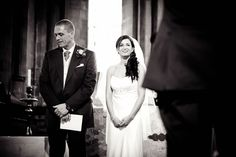 Emily & Eammon's wedding at Wimborne Minster. Bride and father-of-the-bride during the signing of the register.