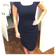 Calvin Klein Navy dress Calvin Klein navy dress. Very elegant and formal. Just above the knee. Lined, dry clean only. Subtle cut outs and design Calvin Klein Dresses